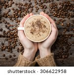 woman holding hot cup of coffee ... | Shutterstock . vector #306622958
