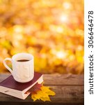 hot coffee and red book with... | Shutterstock . vector #306646478