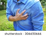 Small photo of Man having chest pain - heart attack, outdoors