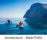 Kayaks. Couple Kanoeing In The...