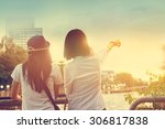 Small photo of Two women take a sight seeing near the river in the nature sky background, Vintage color tone
