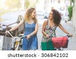 multiracial couple riding bikes ...   Shutterstock . vector #306842102
