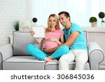 young pregnant woman with... | Shutterstock . vector #306845036