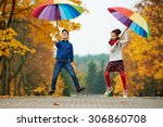 boy and girl among the leaves... | Shutterstock . vector #306860708