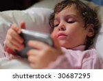 little girl in bed with... | Shutterstock . vector #30687295