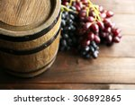 Old Wine Barrel And Grape On...