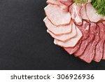 cutting ham assortment on black ...   Shutterstock . vector #306926936