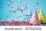colored confetti and party hat... | Shutterstock . vector #307022426