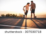 outdoor shot of fit young... | Shutterstock . vector #307030718