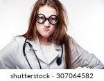 funny doctor holding a pill   Shutterstock . vector #307064582