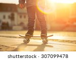 child with skateboard on the...   Shutterstock . vector #307099478