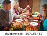 family dinning together | Shutterstock . vector #307158452