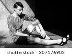 sitting man   black and white... | Shutterstock . vector #307176902