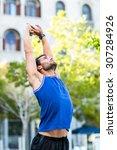 an handsome athlete enjoying... | Shutterstock . vector #307284926