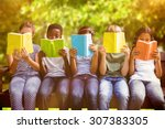 children reading books at park... | Shutterstock . vector #307383305