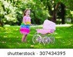 Little Girl Pushing Toy...