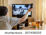 man playing war video game on... | Shutterstock . vector #307458335
