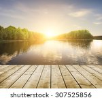 forest lake and wooden board... | Shutterstock . vector #307525856