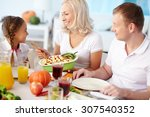 happy family of three dining... | Shutterstock . vector #307540352
