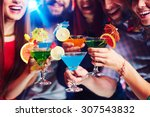 young people drinking cocktails ...   Shutterstock . vector #307543832