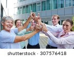 many cheering business people... | Shutterstock . vector #307576418