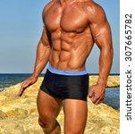 strong bodybuilder with six... | Shutterstock . vector #307665782