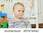 portrait of sweet baby   with a ... | Shutterstock . vector #307676462