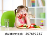 child eating healthy food in... | Shutterstock . vector #307693352