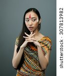 Small photo of beauty young asian girl with make up like Pocahontas, red indians woman fashion, vietnamese