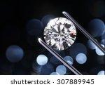 luxury diamond in tweezers...   Shutterstock . vector #307889945