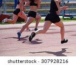 runners on the running track | Shutterstock . vector #307928216