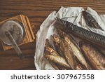 Smoked Fish On Paper  Wooden...