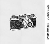 retro camera drawing on paper | Shutterstock . vector #308019638