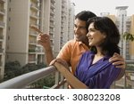 couple standing on a balcony | Shutterstock . vector #308023208