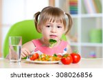 kid girll eating healthy food... | Shutterstock . vector #308026856