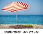 striped beach umbrella on the... | Shutterstock . vector #308195222