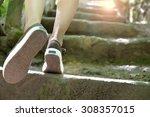 Woman Climbing Stone Steps To...