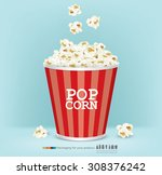 Carton Bowl Full Of Popcorn An...