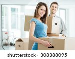 happy smiling couple moving in... | Shutterstock . vector #308388095