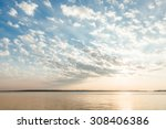 clouds and sun rays over lake... | Shutterstock . vector #308406386