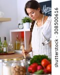 cooking woman in kitchen with... | Shutterstock . vector #308500616