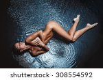beautiful nude woman in aqua in ... | Shutterstock . vector #308554592