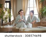 two young happy women drinking...   Shutterstock . vector #308574698