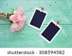 photo frames on vintage wood...   Shutterstock . vector #308594582