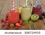 various berry smoothies on a... | Shutterstock . vector #308724935