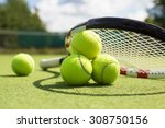 tennis balls and racket on the...