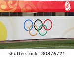 SHENYANG, CHINA - AUGUST 9:  The Olympic Rings are displayed in Shenyang Olympic Sports Center Stadium prior to a soccer match at the Beijing Olympic Games August 9, 2008 in Shenyang, China. - stock photo