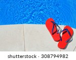 pair of red flip flops on the...