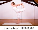 a young woman practicing yoga... | Shutterstock . vector #308802986