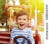 happy little boy driving a car... | Shutterstock . vector #308826542